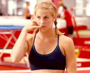 """Still photo from movie """"Stick It"""" of gymnast Mina Hoyt (Maddy Curley) talking on an imaginary phone"""