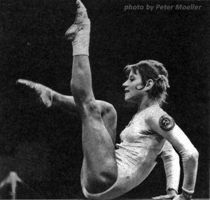 photo of gymnast Olga Korbut in a pose on balance beam